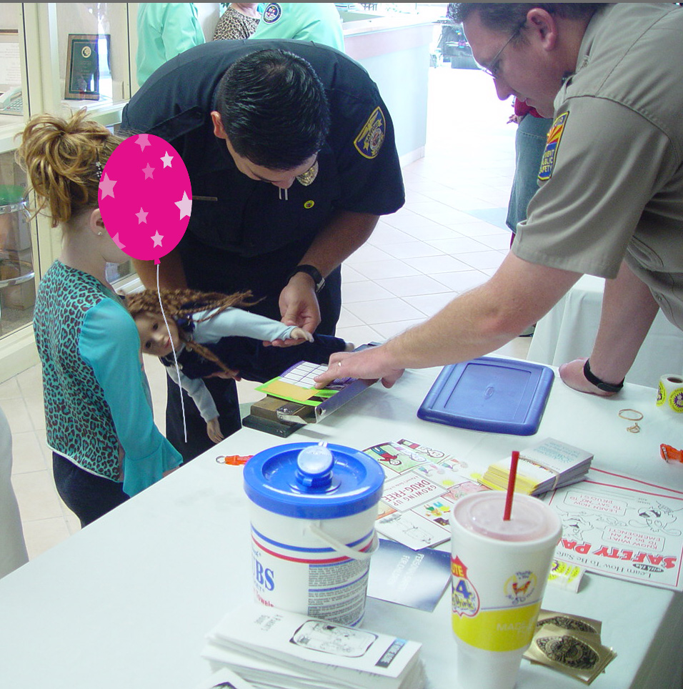 Officer Fingerprinting Child copy